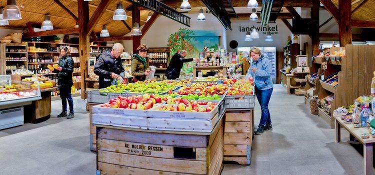 Bezoek aan fruitbedrijf de Woerdt en prachtige rondrit van hoog tot laag